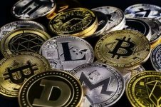 127991356-a-lot-of-cryptocurrency-coins-lie-on-a-dark-surface-background.jpg